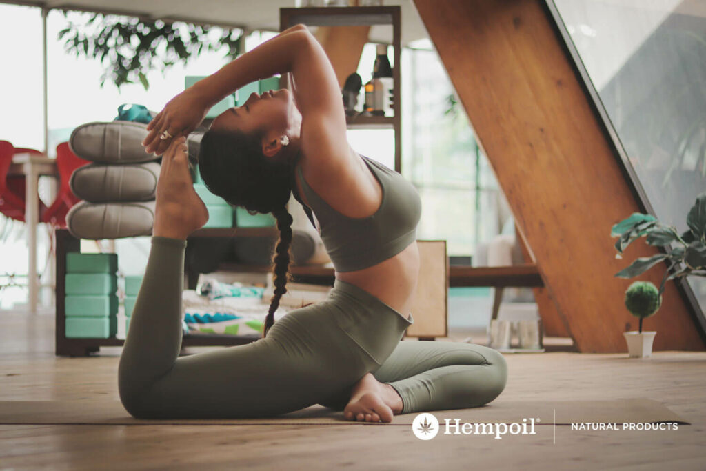 Yoga practitioner uses CBD cannabidiol enecta nutritional supplement.