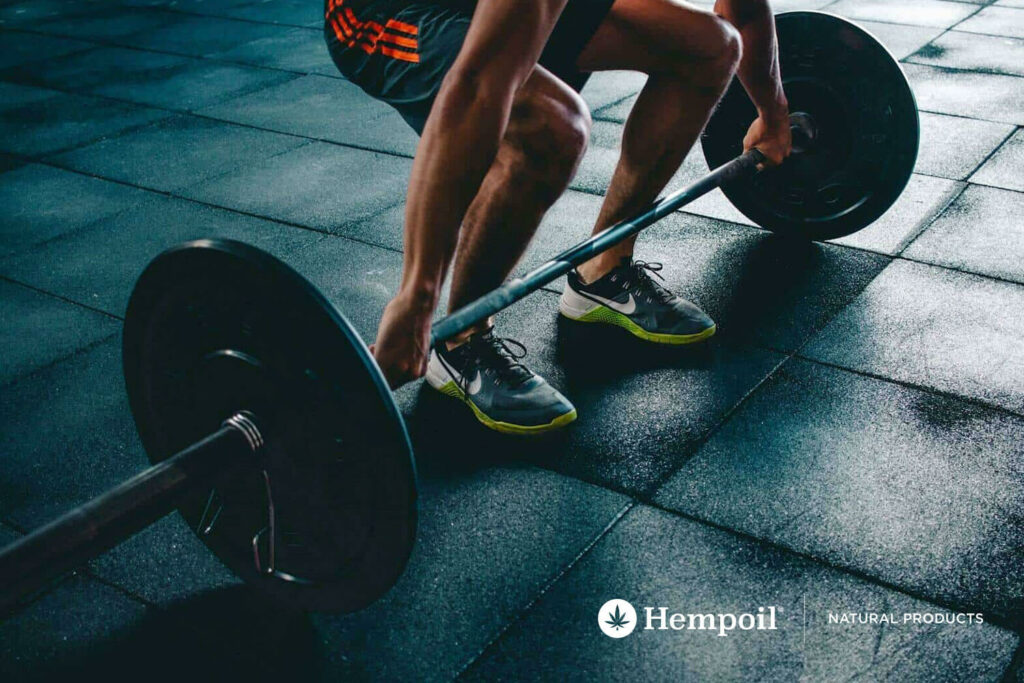 Crossfit athlet and dumbbells with CBD Cannabidiol.